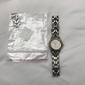 Women's Seiko silver watch with gold accents